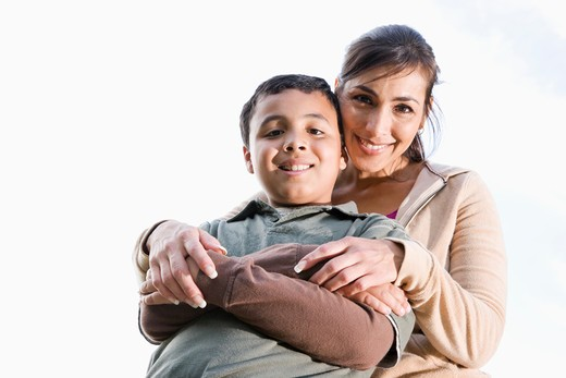 Portrait of Hispanic mother and son outdoors : Stock Photo