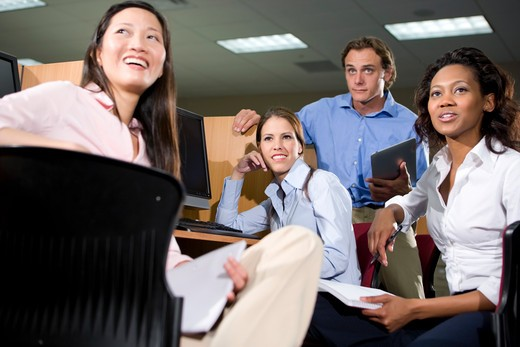 Group of college students studying together : Stock Photo