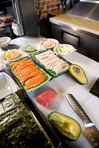 Raw fish and other ingredients for making sushi : Stock Photo