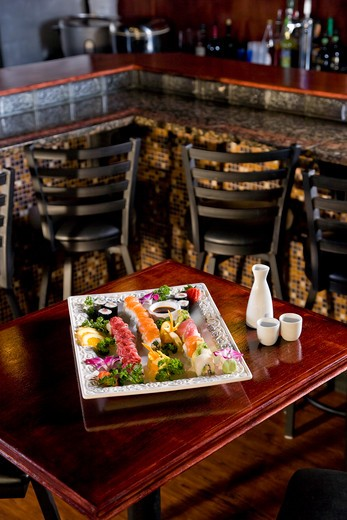 Platter of sushi on table in Japanese restaurant : Stock Photo
