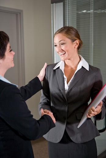 Stock Photo: 4172R-2736 Office workers shaking hands at door of boardroom