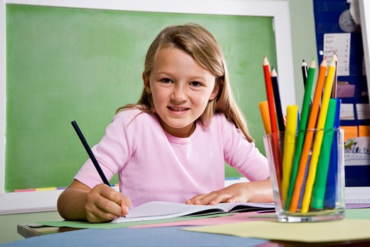 Stock Photo: 4172R-2778 Close-up of school girl writing in notebook