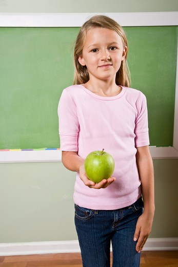 Student with apple for teacher : Stock Photo