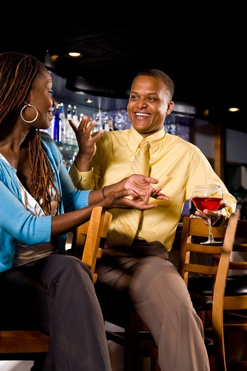 Couple sitting at a bar : Stock Photo