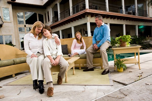 Stock Photo: 4172R-561 Family relaxing on patio together