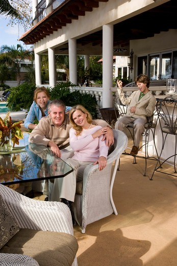 Portrait of carefree family relaxing on outdoor patio : Stock Photo