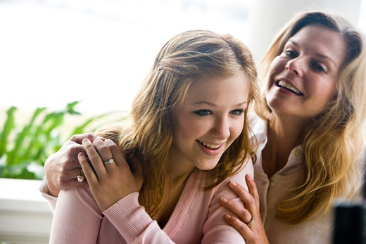 Stock Photo: 4172R-606 Closeup of mother with teenage daughter