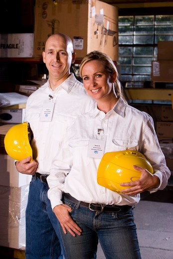 Two co-workers in office storage warehouse : Stock Photo