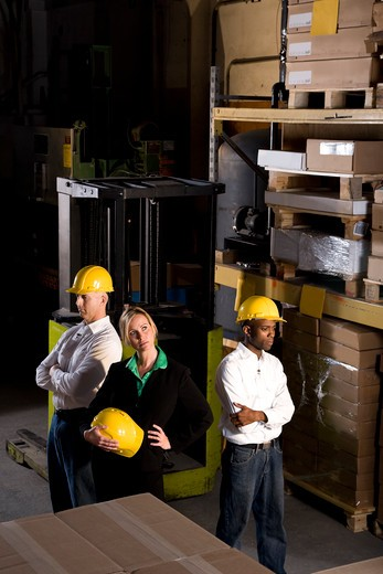 Multi-ethnic workers with female boss in storage warehouse : Stock Photo