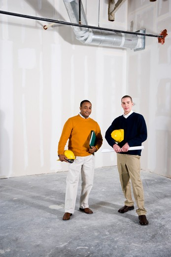 Stock Photo: 4172R-825 Multi-ethnic men in office space ready for buildout