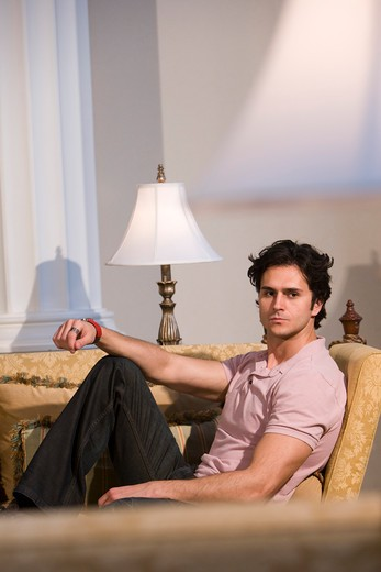 Young man relaxing on living room sofa : Stock Photo