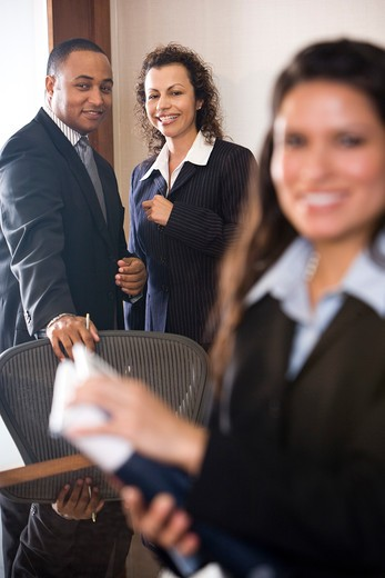 Multi-ethnic business people in boardroom : Stock Photo
