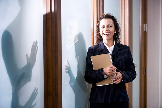 Stock Photo: 4172R-965 Confident Hispanic businesswoman standing in boardroom
