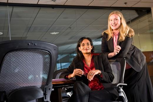 Multi-ethnic businesswomen in boardroom : Stock Photo