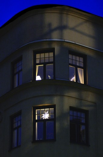 Stock Photo: 4176-10266 Low angle view of apartment building with windows at dusk in Stockholm