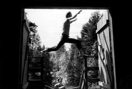 Stock Photo: 4176-1053 A man jumping over a doorway. Sweden
