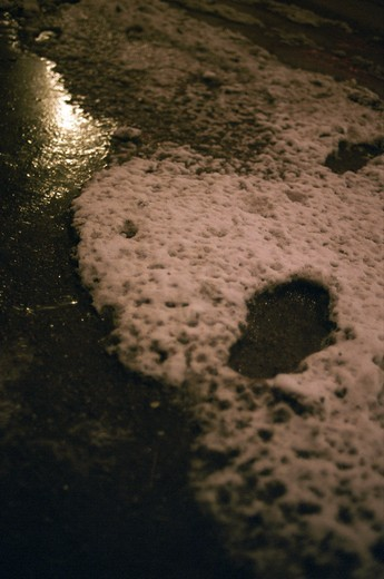 Close up view of footprints in the snow in winter : Stock Photo