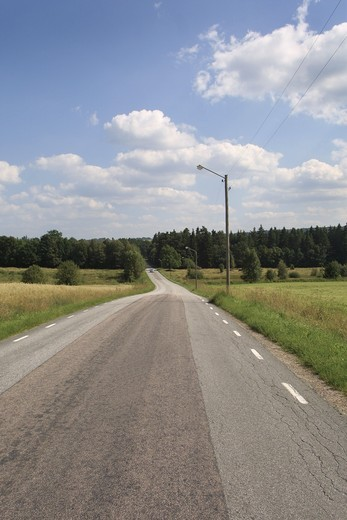 Road passing through a landscape : Stock Photo