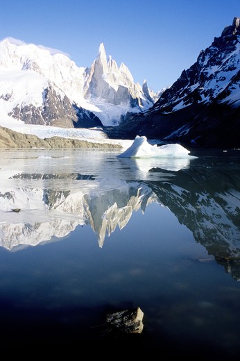 Reflection of a snow covered mountain in a lake, Cerro Torre, Argentina : Stock Photo