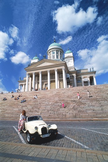 Finnish woman with classic European sports car below Luthern Cathedral at Senate Square in Helsinki Finland : Stock Photo