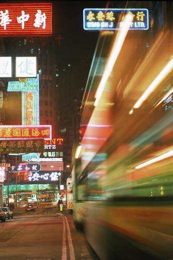 Trams and traffic at night on Hennessy Raod in Causeway Bay Hong Kong : Stock Photo