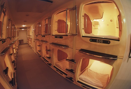 Traditional businessman's capsule hotel with small individual rooms in Japan : Stock Photo