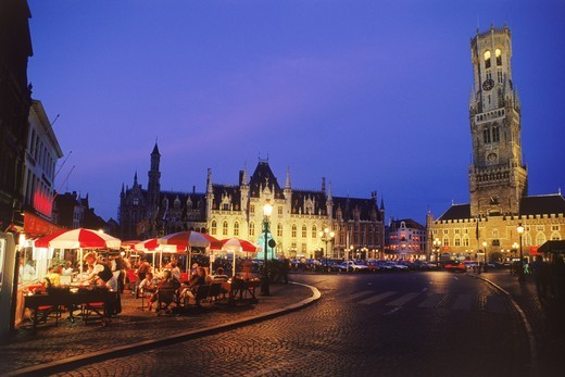 Stock Photo: 4176-14216 Market Square in Brugge with tall Cathedral belfry at night