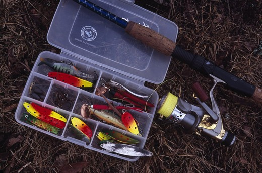 Stock Photo: 4176-16757 Fishing lure and fishing rod with fishing kit
