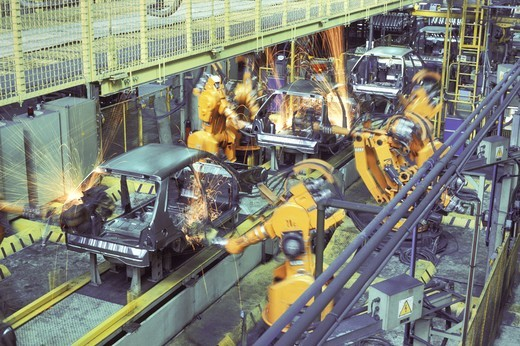 Stock Photo: 4176-17232 AUTOMOTIVE INDUSTRY CAR ASSEMBLY BY ROBOT WELDING