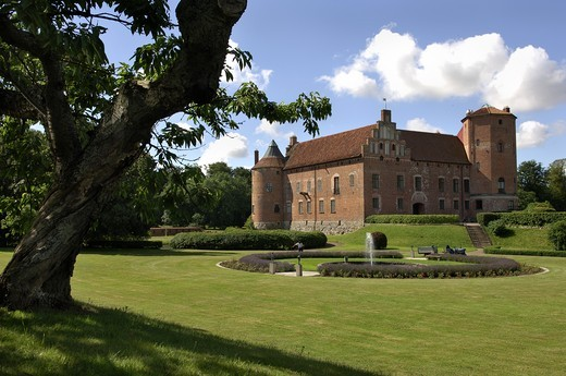Castle Torup with lawn and partially cloudy sky at Sweden : Stock Photo