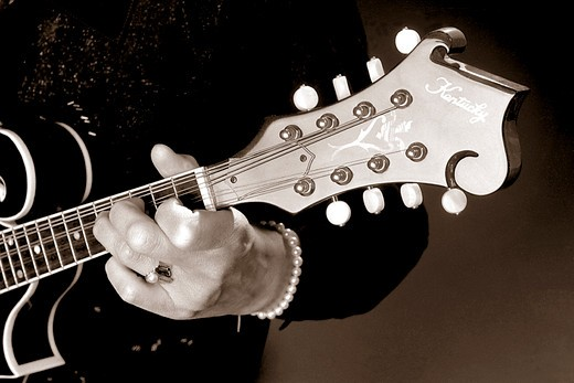 Stock Photo: 4176-192 Woman Playing the Guitar