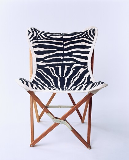 Close-up view of a chair with zebra pattern : Stock Photo