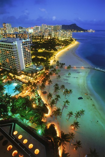 Overview of Waikiki beaches with Diamond Head at twilight : Stock Photo
