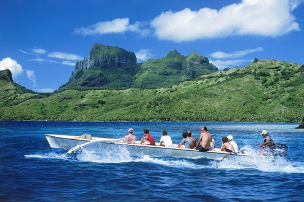 Stock Photo: 4176-20987 Outrigger canoe touring around Island of Bora Bora in French Polynesia