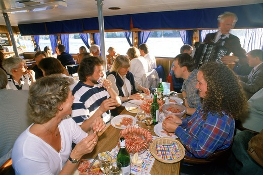 Stock Photo: 4176-21160 Food, music and drinks on the water in boat restaurant cruising around Stockholm