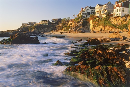 Coastal homes at Woods Cove in Laguna Beach near sunset in Southern California : Stock Photo