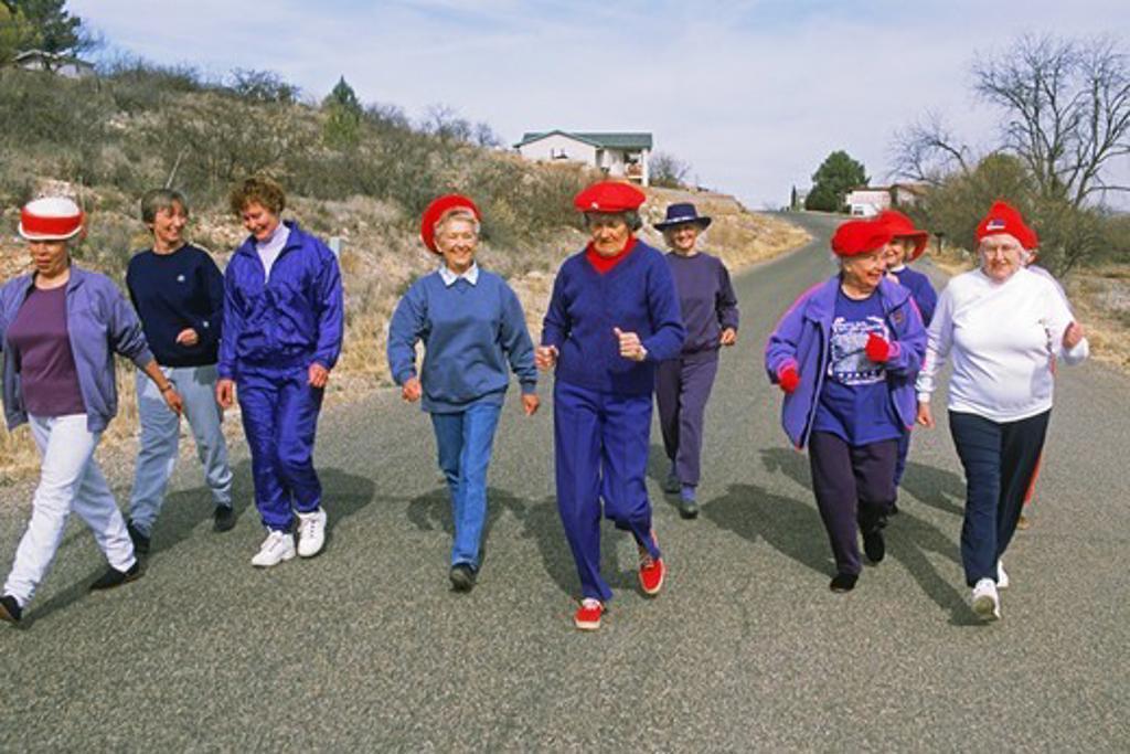 Senior ladies power walking on road in Arizona   USA : Stock Photo