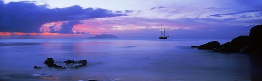 Stock Photo: 4176-21394 Old masted ship anchored in Indian Ocean off  Mahe Island in Seychelles at sunset