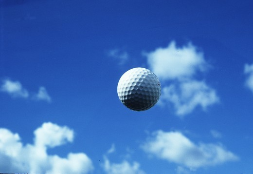 Stock Photo: 4176-21453 Close-up of a golf ball in mid-air