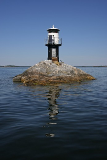 Lighthouse on a small rocky island in Stockholm, Sweden : Stock Photo
