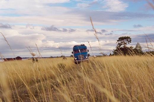 Stock Photo: 4176-23275 Bus passing through a field