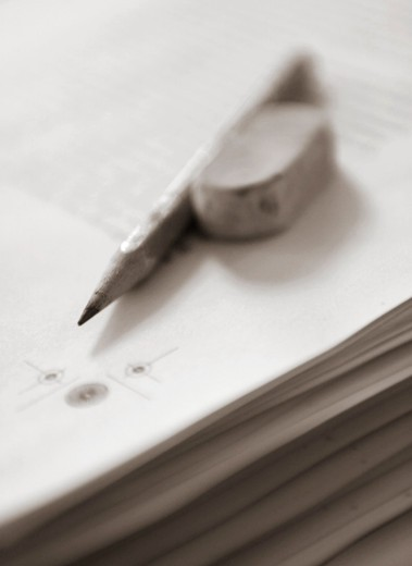 Stock Photo: 4176-24196 Close-up of a pencil and an eraser on a stack of papers
