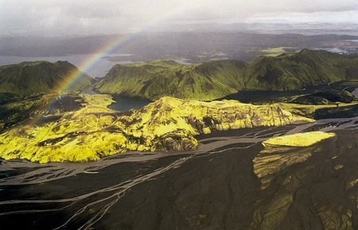 Iceland - Aerial view of rainbow over mountains and river : Stock Photo