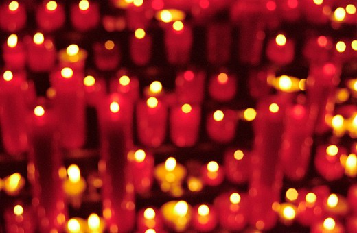 Close-up of burning candles in a church, Barcelona, Spain. : Stock Photo