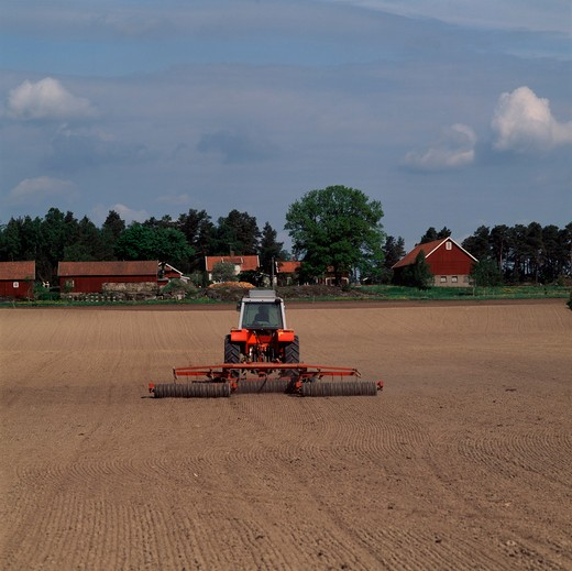 Stock Photo: 4176-26243 Sweden - Tractor ploughing a field