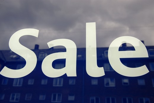 Sale sign on a glass with reflections of house. : Stock Photo