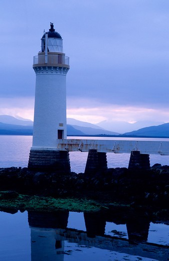 Stock Photo: 4176-26576 Scotland - Reflection of a lighthouse in water