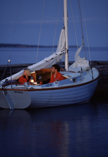 Mid adult couple in a boat : Stock Photo