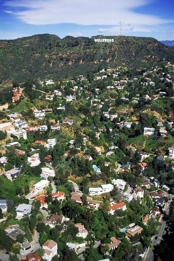 Stock Photo: 4176-27387 Aerial view of exclusive hillside homes below Hollywood sign in Hollywood Hills, California