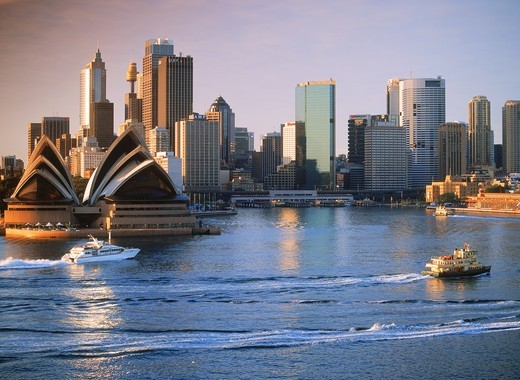 Stock Photo: 4176-27662 Boat taxis crossing Sydney Harbor with Opera House and skyline at dawn